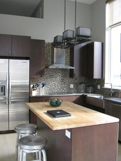 Cohen contemporary kitchen  backsplash and lights and cabinets