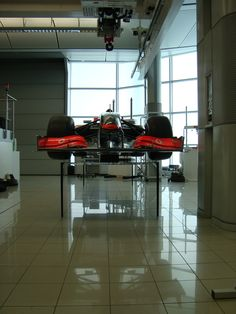Established & Sons: Surface table supporting the McLarenF1.  Kortrijk Exhibition, Belgium, 2010