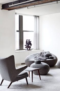 soft grey chairs and ottomans | Will Ferrell's NY loftspace
