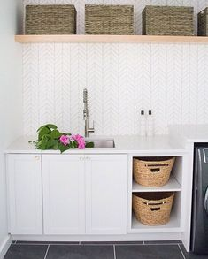 Come see this modern laundry room remodel with a folding counter and built in laundry sorter. Laundry Room Organization, Laundry Room Design, Laundry Sorter, Organizing, Diy Wall Decor, Room Decor, Feather Wallpaper, Unique Wallpaper, Laundry Room Wallpaper
