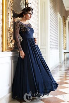 ffa11fb8e82764 Blue Silk Anarkali Blue coloured waist cinching anarkali suit in tabby silk  with gold embellishment around the sleeves.