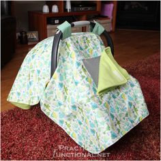 We don't have one yet, but it would be nice.... or you can use a baby blanket, however, you will have to hold it in place, and make sure not to drop it on the floor/ let it get carried away in the wind.  I'm sure for those that are crafty, you can probably make one- I would make one with the top side being water proof, in case you're out and about, in the rain.