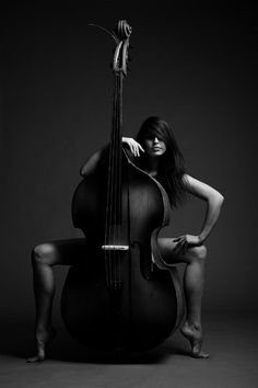 The instrument is suggestive of the woman's form, or the photographer is being suggestive?
