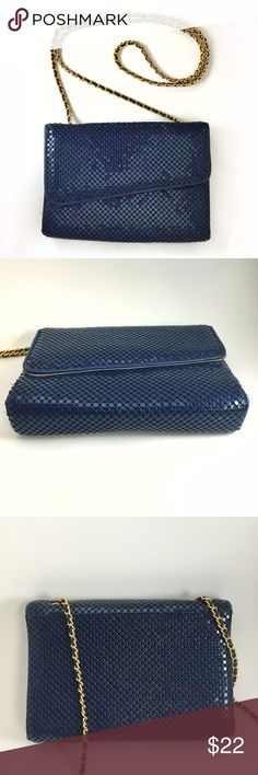 """Vintage blue mesh evening bag with chain strap Pretty evening purse in very good used (vintage) condition. The paint is scratched off on the front corner, and there is a break in the material woven through the chain strap. The inside has a few spots on the flap and on the side wall. Inside has one small zip pocket. Measures 6"""" tall x 8.5"""" wide x 1.5"""" deep, with 23"""" strap drop. Tag inside says the brand is Bueno. Vintage Bags Shoulder Bags"""
