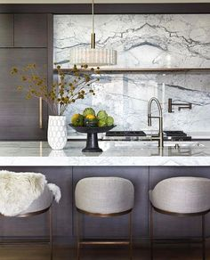 Warm grey wood, marble backsplash, overall warm yet modern feel. Interior Design by Nam Dang Mitchel