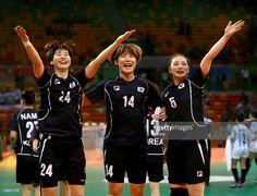 Han Na Gwon #24,Jinyi Kim #14 and Yura Jung #5 of Korea celebrate the win over…