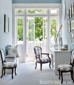 Antique Louis XV chairs are updated in plaid in a pretty blue office space. - Photo:  Emily Jenkins Followill / Design: Carolyn Griffith