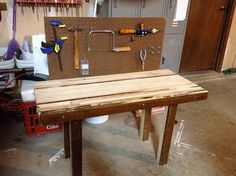 Kids work bench.  a cool way for kids to be introduced to woodworking, having their very own bench with a selection of hand tools!