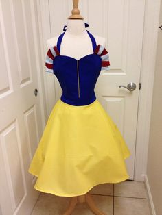 This is an adult size Snow White costume apron. Made of cotton.The skirt is a wrap style that provides full coverage in back yet is adjustable to fit