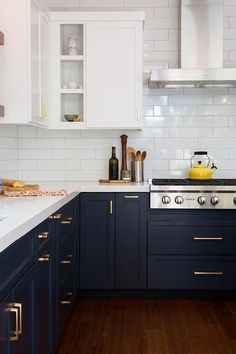 White and blue kitchen features white upper cabinets and navy blue lower cabinets adorned with aged brass pulls paired with white quartz countertops that resemble marble and a white stacked tile backsplash.: Kitchen Cabinets, Diy, Home Decor, Kitchen Cabinetry, Build Your Own, Homemade Home Decor, Bricolage, Kitchen Base Cabinets, Interior Design