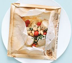 Scallops in Parchment: This meal couldn't be easier—just combine scallops, tomatoes, white beans, and sliced fennel in a parchment packet and bake for 15 minutes.