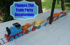 Thomas the Train Party decorations - DIY birthday party table decorations perfect for any train party. These easy to create food trains will be sure to impress even the smallest engineer Thomas the Train Birthday Party Thomas The Train Birthday Party, Trains Birthday Party, Birthday Party Tables, Birthday Diy, Diy Birthday Party Table Decorations, Decoration Table, Zug Party, Crafts For Teens To Make, Diy Table