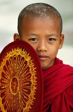 A Boy on the Street in Yangoon, Burma (Photography by by Dennis Thern)