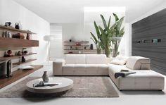salon moderne blanc avec canapé d'angle et table ultra basse ronde
