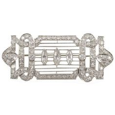 Art Deco White Gold, and Diamond Brooch | From a unique collection of vintage brooches at https://www.1stdibs.com/jewelry/brooches/brooches/