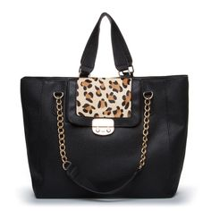Beautiful Leather Bag with an animal print panel that adds an exotic contrast.