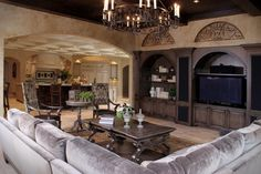 Sophisticated and luxurious living room with velvet sectional couch.  1 of 10 projects by House of L.