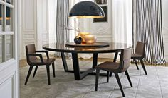 XILOS | The dining table features a wooden base in the form of a cross. The round version has the option of a central revolving tray. | www.moderndiningtables.net  #moderndiningtable #interiordesign #roundtable #diningtable