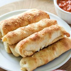 Forget frozen pizza rolls! These Homemade Pepperoni Rolls are made with refrigerated pizza dough, mozzarella cheese sticks and pepperoni for an easy dinner or snack! Made famous in West Virginia, these Pizza Rolls will become a family favorite! #pizzarolls #recipesforkids #lunchboxideas #snacksforkids #pizzarolls #pepperonirolls Frozen Bread Dough, Frozen Pizza, Easy Pepperoni Rolls, Pepperoni Bread, West Virginia Pepperoni Rolls Recipe, Pillsbury Pizza Crust Recipes, Easy Homemade Pizza, Homemade Cheese Sticks, Pizza