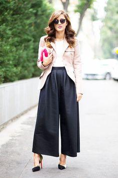 Eleonora Carisi in black culottes and blazer.