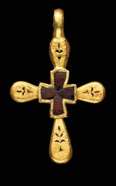 A BYZANTINE GOLD AND GARNET PENDANT CROSS. Circa 600 A.D. The rounded arms each tapering toward the cruciform central element, each arm with a deeply engraved foliate motif, the central element with four bezel set garnets, a thick suspension loop above.
