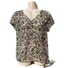 """Lucky Brand Sz M Chiffon Short Sleeve Blouse NWOT Lucky Brand Sz M Chiffon Short Sleeve Blouse NWOT Length 25""""Bust 21"""" across from pit to pit.100% PolyesterFloral vine patterndrawstring waistButton down vneck Lucky Brand Tops Blouses"""