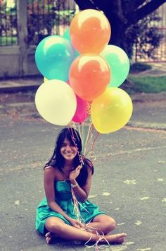 i want to begin this year with a tradition of taking the kids pictures with the number of balloons coordinating with their age! :)