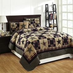 The Revere King Quilt Set by Olivia's Heartland features a black and tan contrast with a hint of red. Plaids and solids are patched together in squares and stars and each star is surrounded with embroidery. Perfect for your country primitive home or cabin decor, this quilt brings bold tones and warmth to your space. It has 100% cotton shell and fill and is hand quilted with stitch in the ditch quilting. Includes two King Size Shams.