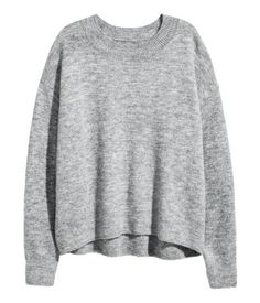 Dark gray melange. Oversized sweater in a soft, fine knit with wool content. Dropped shoulders, ribbing at neckline, cuffs, and hem, and slightly longer