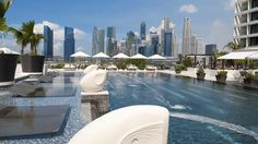 Mandarin Oriental, Singapore's 25-metre pool sits in the wonderful setting in Marina Bay and features luxurious private cabanas
