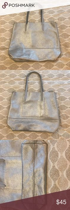 J. Crew Downing Tote This roomy yet polished tote bag proves your work bag, errands bag, gym bag and going-out bag can all be the same bag. This one is made from a special leather that gets softer with use. Silver coating on a light grey leather makes for a perfect transitional tote from day to note. Spacious enough for a laptop, beach towels or even as an overnight bag. Interior zip pocket. Super soft! Good condition!! Open to offers J. Crew Bags Totes