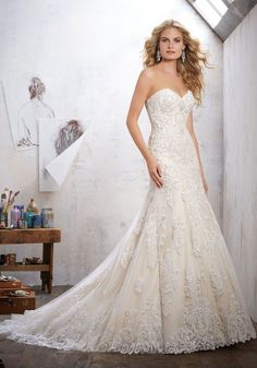 c4c6bdc569 Strapless Bridal Gown featuring a Sweetheart Neckline and Beaded Lace on  Net. Wide Scalloped Hemline. Morilee by Madeline Gardner