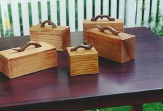 """These are band-saw boxes made from 8""""x8"""" redwood post.  Black walnut handles"""