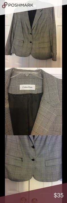 Calvin Klein Checkered Blazer Calvin Klein checkered blazer with front buttons and front pockets with flaps and long sleeves and buttons on sleeves with v- collared neck line and fully lined  65% polyester and 33% rayon and 2% spandex Calvin Klein Jackets & Coats Blazers