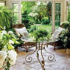 I like this furniture for screen porch - scrolled iron leg glass top table and comfortable wicker / rattan seating