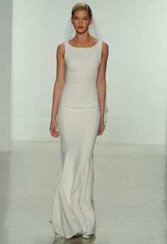This minimalist shift style wedding dress is perfect for the bride looking for a simple but sophisticated look on her day.