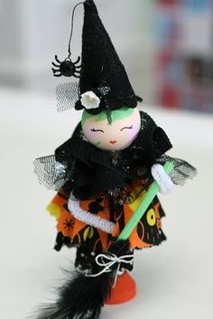adorable little Halloween pipe cleaner witch doll.