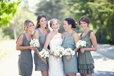 Love these bridesmaids dresses/flower combo