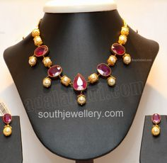studded with large rubies and south sea pearls, paired up with matching earrings by RR Jewellers, Hyderabad.Necklace studded with large rubies and south sea pearls, paired up with matching earrings by RR Jewellers, Hyderabad. Ruby Jewelry, Bridal Jewelry, Beaded Jewelry, Ruby Necklace, Pearl Necklaces, Statement Jewelry, Coral Jewelry, Pretty Necklaces, Bead Jewellery