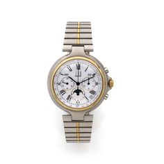 DUNHILL VERS 1990 Montre bracelet avec chronographe, triple quantième et phases de lune. Boîti