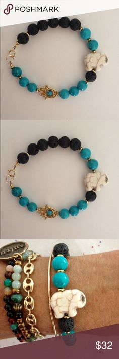 """Spiritual Essential Oil Bracelet Beautiful Turquoise Howlite and Lava Stone! Features Lucky Elephant Focal Stone and Gold Hamsa Hand Turkish Protection Symbol.Gold Filled Clasp! 7 1/4""""Custom Size AvailableIncludes Sample of Essential Oil Jewelry Bracelets"""