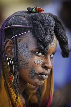 Wodaabe woman with facial tattoos — in Niger.""