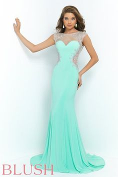 Eye catching and fabulous! This stunning floor length jersey knit features a badeau style neckline of illusion mesh completely adorned with AB crystals and silver beading. The mesh also covers the cut out sides and trims the swooping open back playfully showing off your figure. Back zipper closure. Available in Mint Green and Navy. #BlushProm #BlushProm2015 #promdress