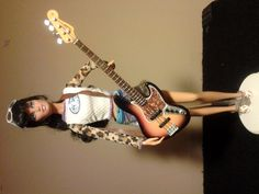 Barbie with a 1/6 scale model Fender Jazz Bass