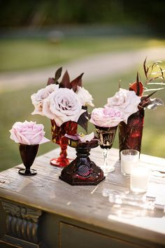 red glass vases paired with pale #pink #roses |  Photography by nextexitphotography.com, Event Design by http://www.kristeenlabrotevents.com, Florals by http://kristajon.com  Read more - http://www.stylemepretty.com/2013/08/23/saddlerock-ranch-wedding-from-kristeen-labrot-events/