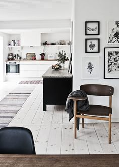 the untreated floors . the striped rugs . the kitchen corner . the wall art .