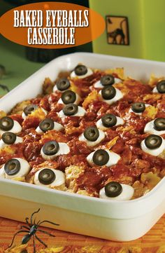 Baked Eyeballs Casserole Recipe - The eyeballs that top our spooky casserole are made from mozzarella cheese and sliced olives. But the cheesy, baked pasta that lies below is a real treat that everyone will enjoy. Halloween Desserts, Halloween Themed Food, Halloween Eyeballs, Halloween Dinner, Halloween Treats, Halloween Foods, Halloween Food Dishes, Halloween Potluck Ideas, Halloween Pizza