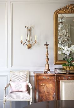 A touch of pink provides a modern accent to antiques in the dining room.