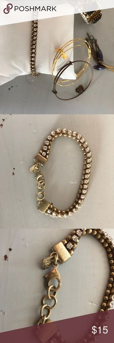 Crystal bracelet Great layering bracelet! Brown thread and gold metal /crystal stone bracelet. 3 rings at clasp closure to adjust wrist size. Some scratches on clasp- needs a little buff ! Cute costume piece. Banana Republic Jewelry Bracelets