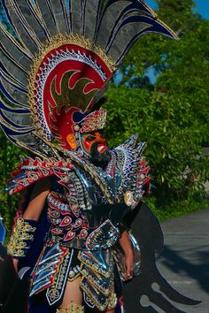 Semana Santa with Moriones Festival The festival is characterized by colorful Roman costumes, painted masks and helmets and brightly colored tunics. Moriones Festival, Holy Week, Floral Arrangements, Philippines, Captain Hat, Travel Photography, Costumes, Halloween, Dress Up Clothes